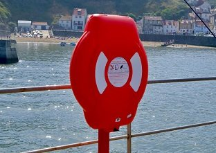 The highly visible Guardian lifebuoy housing protecting life-saving devices inside from harmful UV degradation