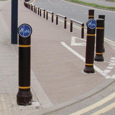 Black Mini-Ensign bollard with amber retroreflective banding and sign Ref 957 Reversed